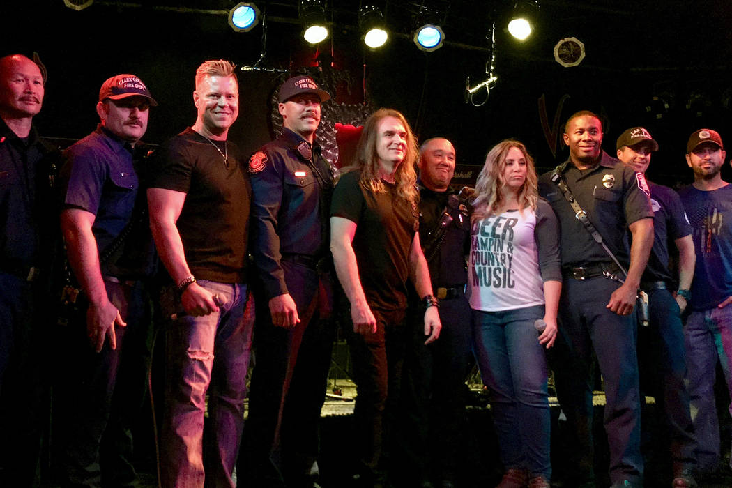 David Ellefson, center, poses for a photo with first responders at Count's Vamp'd Rock Bar & Grill Oct. 5.(Madelyn Reese/View) @MadelynGReese