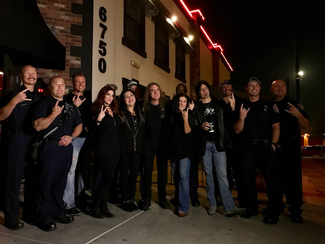 David Ellefson, center, poses for a picture with first responders and fans outside Count's Vamp'd Rock Bar & Grill Oct. 5. (Madelyn Reese/View) @MadelynGReese