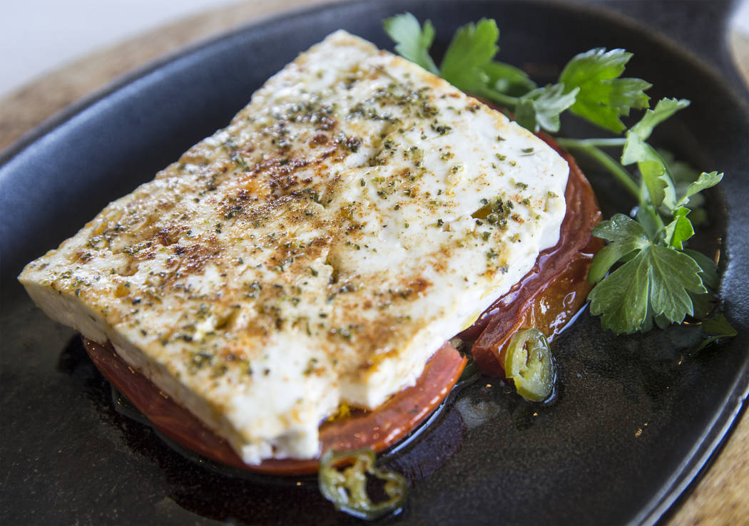 Roasted feta with oven baked feta cheese, fresh tomato and serrano peppers at Elia on Wednesday, October 11, 2017, in Las Vegas. Benjamin Hager Las Vegas Review-Journal @benjaminhphoto