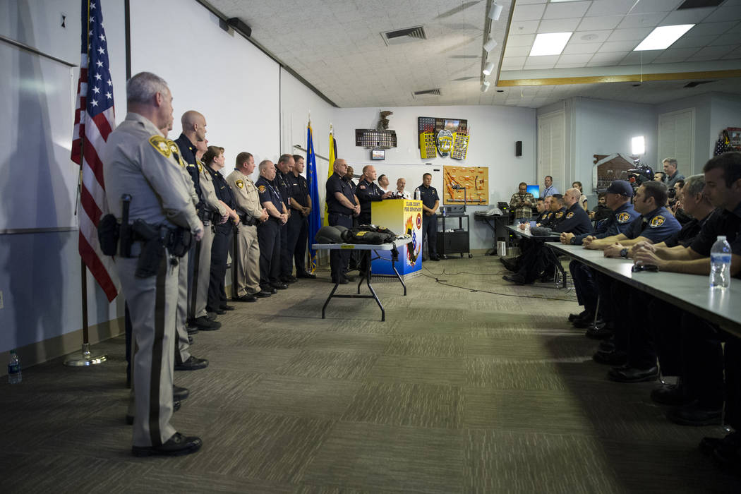 Las Vegas police officers and Clark County firefighters during a press conference on the fire and emergency medical service response to Sundays' mass shooting, at the Clark County Fire Department  ...