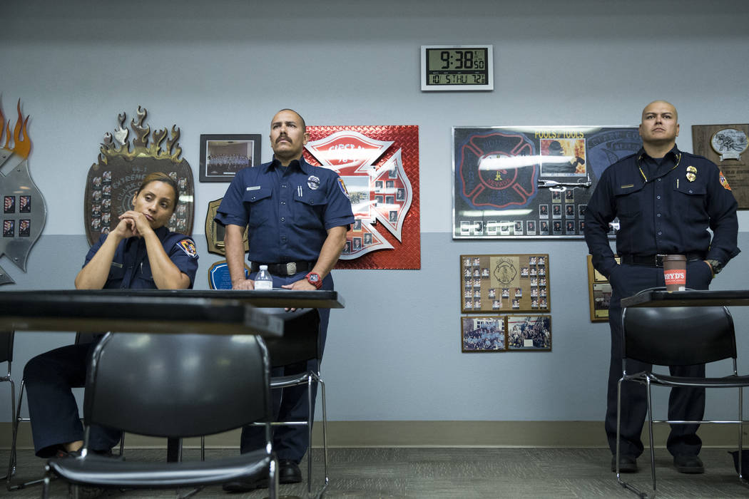 Clark County Fire Department Training Instructors from left, Christa Fells, Chris Carbajal, and Emergency Manager for the North Las Vegas Fire Department Carlito Rayos, during a press conference o ...
