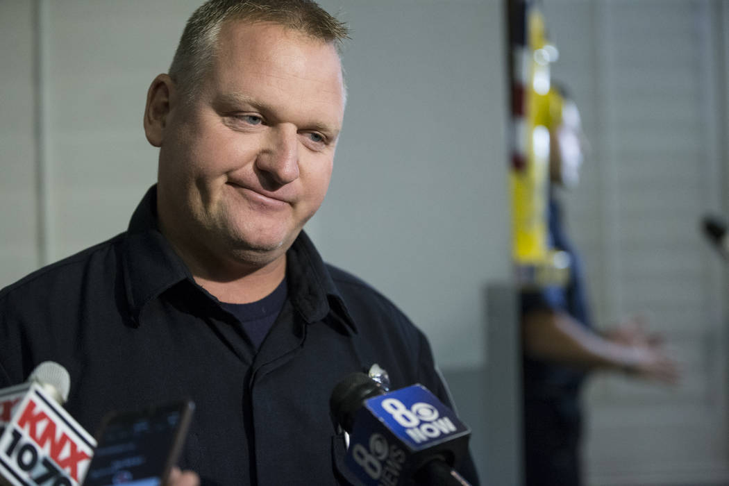 Clark County Firefighter Jeff Koceski is interviewed following a press conference on the fire and emergency medical service response to Sundays' mass shooting, at the Clark County Fire Department  ...