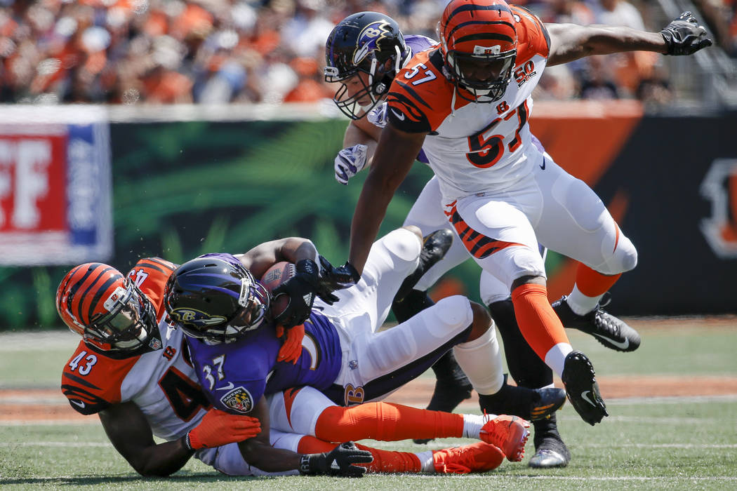 Baltimore Ravens running back Javorius Allen (37) is tackled by Cincinnati Bengals free safety George Iloka (43) in the first half of an NFL football game, Sunday, Sept. 10, 2017, in Cincinnati. ( ...