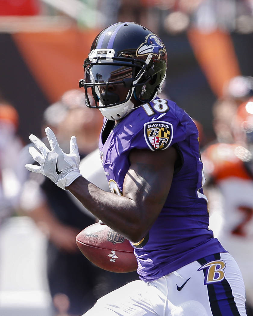 Baltimore Ravens wide receiver Jeremy Maclin runs the ball in for a touchdown in the first half of an NFL football game against the Cincinnati Bengals, Sunday, Sept. 10, 2017, in Cincinnati. (AP P ...