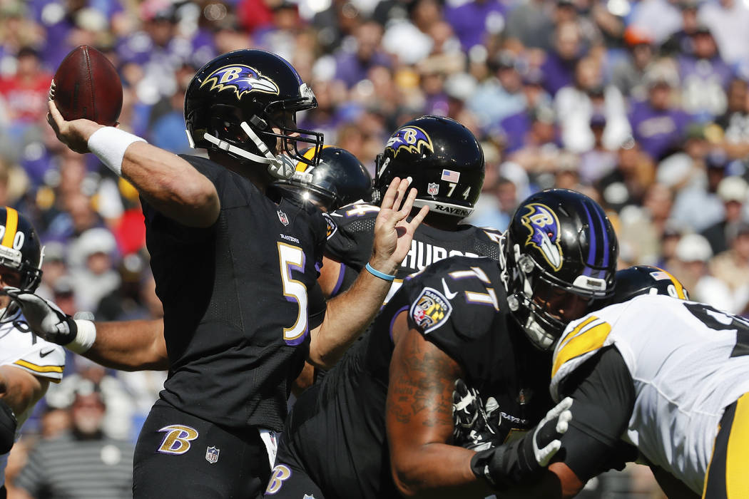 Baltimore Ravens quarterback Joe Flacco (5) passes the ball during the first half of an NFL football game against the Pittsburgh Steelers in Baltimore, Sunday, Oct. 1, 2017. (AP Photo/Alex Brandon)