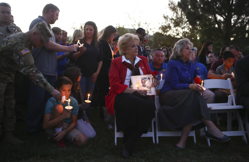 Mayor Carolyn Goodman, center, and U.S. Rep. Dina Titus, D-Nev., right, during a candlelight vigil for Las Vegas police officer Charleston Hartfield, who was killed while off-duty in Sunday's mass ...