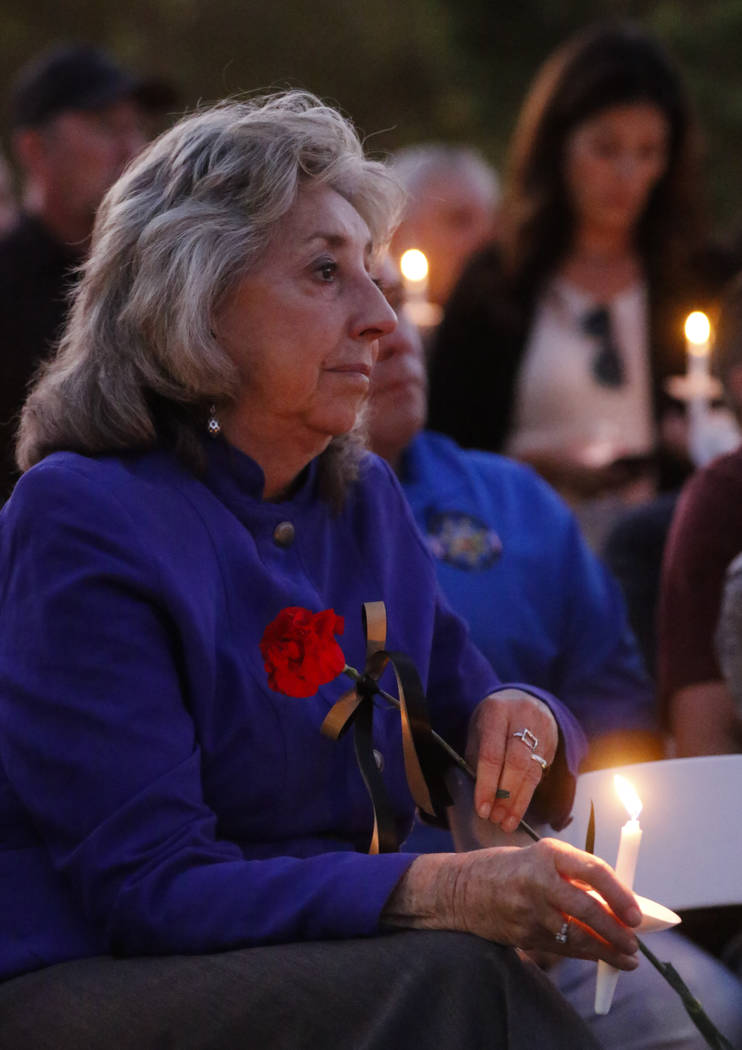 U.S. Rep. Dina Titus, D-Nev., during a candlelight vigil for Las Vegas police officer Charleston Hartfield, who was killed while off-duty in Sunday's mass shooting, at Police Memorial Park in Las  ...