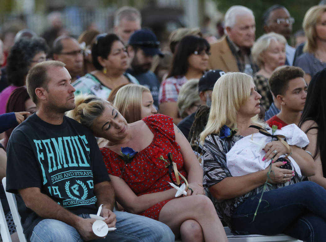 Family and friends during a candlelight vigil for Las Vegas police officer Charleston Hartfield, who was killed while off-duty in Sunday's mass shooting, at Police Memorial Park in Las Vegas on Th ...