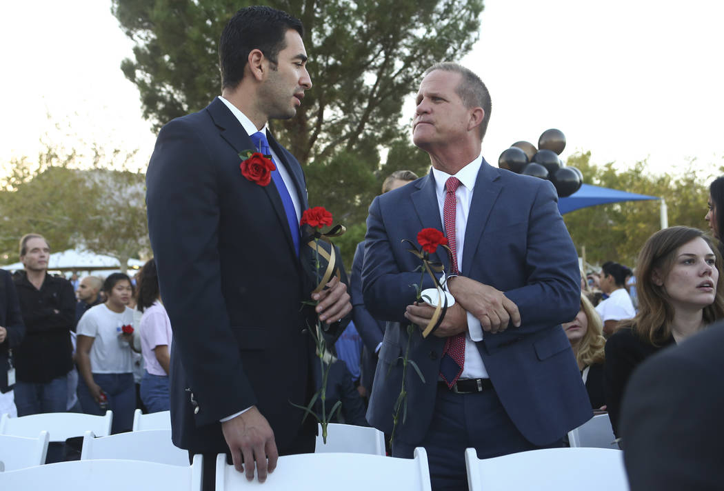 U.S. Rep. Ruben Kihuen, D-Nev., and Nevada Lt. Gov. Mark Hutchison during a candlelight vigil for Las Vegas police officer Charleston Hartfield, who was killed while off-duty in Sunday's mass shoo ...