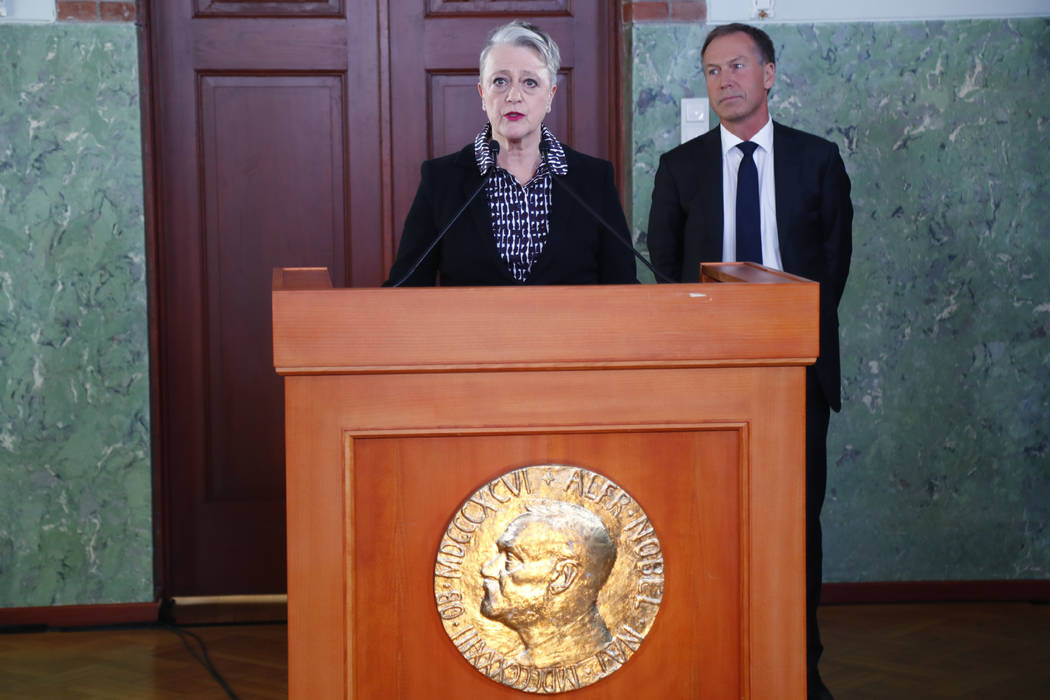 Berit Reiss-Andersen, chair of the Norwegian Nobel Committee, announces thee 2017 Nobel Peace Prize goes to ICAN, International Campaign to Abolish Nuclear Weapons in Oslo Friday Oct. 6, 2017. The ...