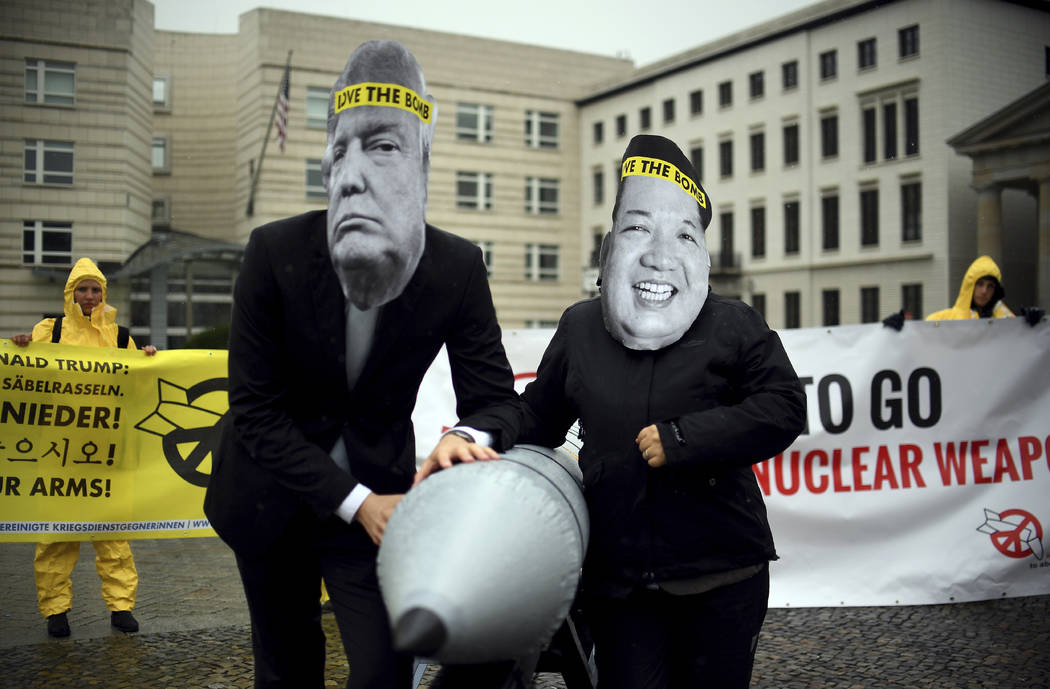 Activists of the International Campaign to Abolish Nuclear Weapons (ICAN) protest against the conflict between North Korea and the United States in front of the U.S. embassy in Berlin, Germany. (B ...