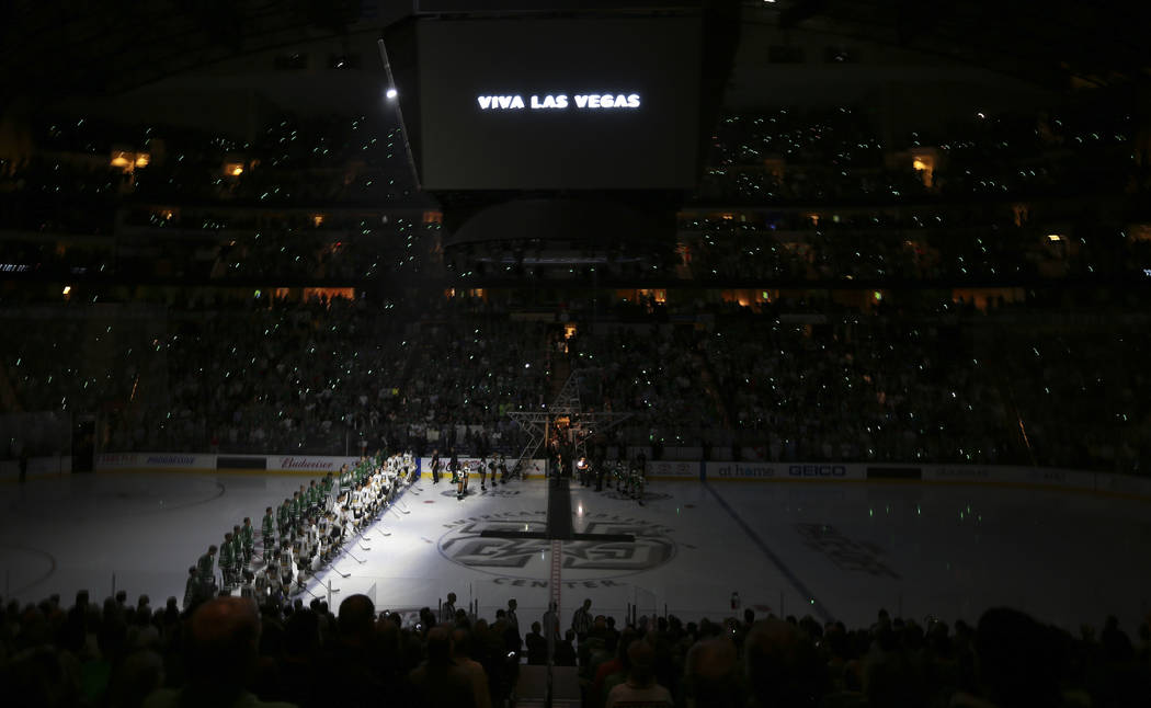 The Dallas Stars and Vegas Golden Knights line up for a moment of silence for shooting victims in Las Vegas before an NHL hockey game in Dallas, Friday, Oct. 6, 2017. (AP Photo/LM Otero)