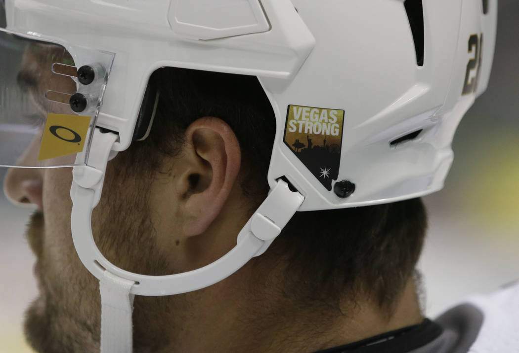 Vegas Golden Knights left wing William Carrier wears a Vegas Strong sticker on his helmet before an NHL hockey game in Dallas, Friday, Oct. 6, 2017. (AP Photo/LM Otero)