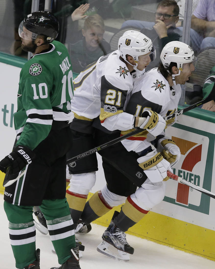 Vegas Golden Knights left wing James Neal (18) celebrates his goal with teammate Cody Eakin (21) during the third period of an NHL hockey game as Dallas Stars center Martin Hanzal (10) skates past ...