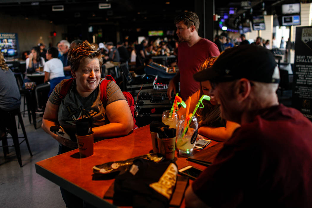 Jeannette Hall of Las Vegas, 32, attends a watch party for the Vegas Golden Knights season opener against the Dallas Stars at Topgolf in Las Vegas, Friday, Oct. 6, 2017. Proceeds from t-shirt sale ...