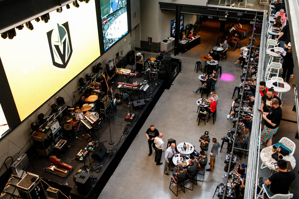 People gather during a watch party for the Vegas Golden Knights season opener against the Dallas Stars at Topgolf in Las Vegas, Friday, Oct. 6, 2017. Proceeds from t-shirt sales at the event went  ...