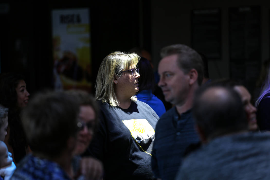 Kathie Del Valle of Las Vegas, 44, attends a watch party for the Vegas Golden Knights season opener against the Dallas Stars at Topgolf in Las Vegas, Friday, Oct. 6, 2017. Proceeds from t-shirt sa ...