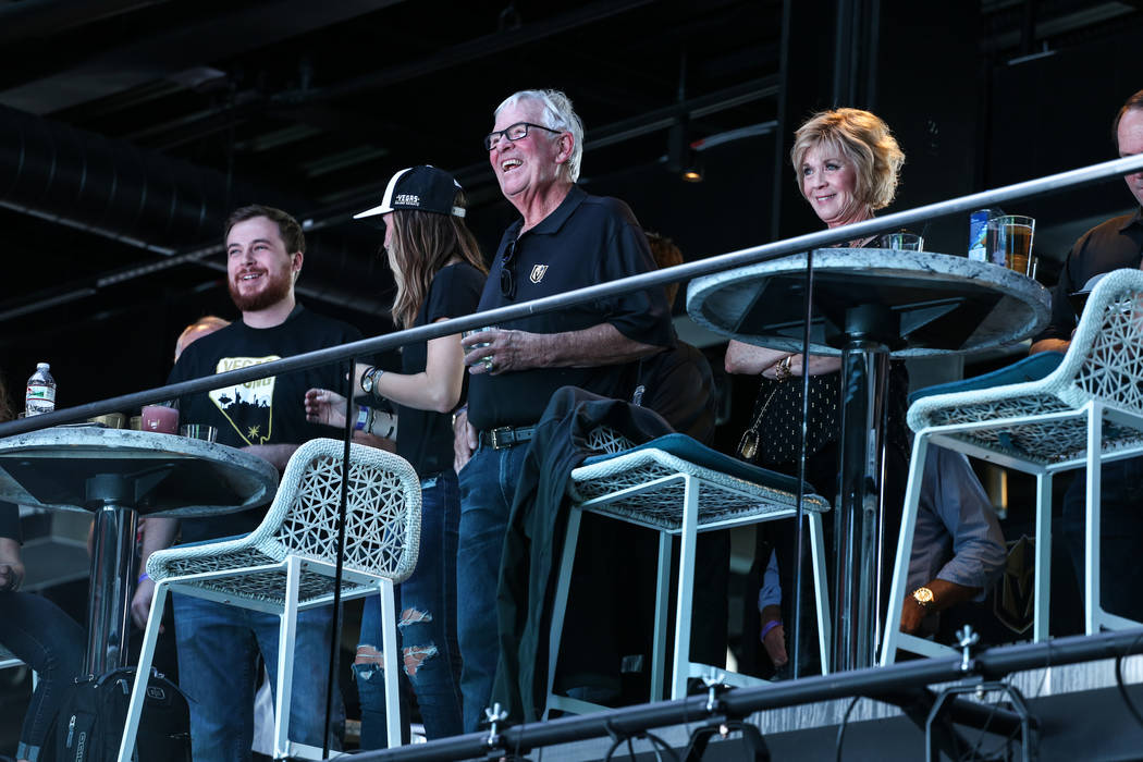 Vegas Golden Knights' owner Bill Foley, second from right, and his wife Carol Johnson Foley, right, attend a watch party for the Vegas Golden Knights season opener against the Dallas Stars at Topg ...