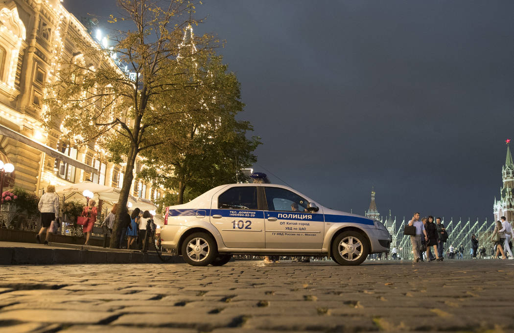 A police car is parked in front of the GUM, State Shop, at Red square in Moscow, Russia on Wednesday, Sept. 13, 2017. (Pavel Golovkin/AP)