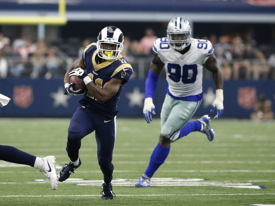 Los Angeles Rams wide receiver Tavon Austin (11) carries the ball as Dallas Cowboys defensive end DeMarcus Lawrence (90) gives chase during an NFL football game, Sunday, Oct. 1, 2017, in Arlington ...