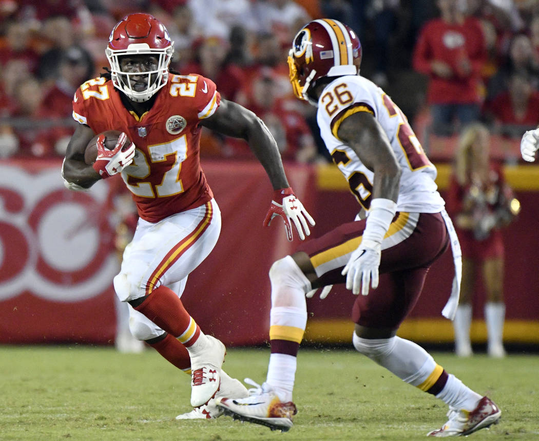 Kansas City Chiefs running back Kareem Hunt (27) runs away from Washington Redskins cornerback Bashaud Breeland (26) during the second half of an NFL football game in Kansas City, Mo., Monday, Oct ...