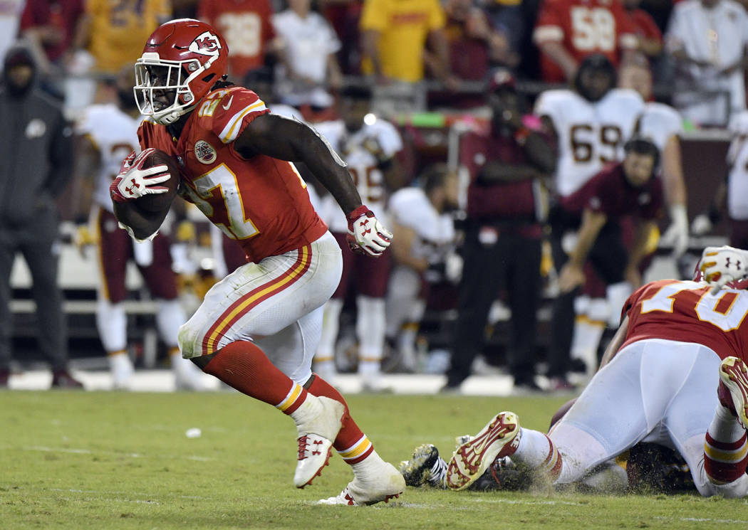 Kansas City Chiefs running back Kareem Hunt (27) carries the ball during the second half of an NFL football game against the Washington Redskins in Kansas City, Mo., Monday, Oct. 2, 2017. (AP Phot ...