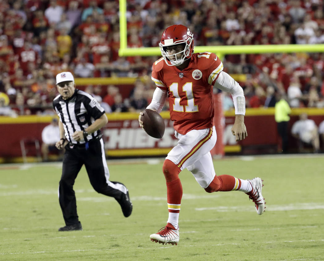 Kansas City Chiefs quarterback Alex Smith (11) carries the ball during the second half of an NFL football game against the Washington Redskins in Kansas City, Mo., Monday, Oct. 2, 2017. (AP Photo/ ...