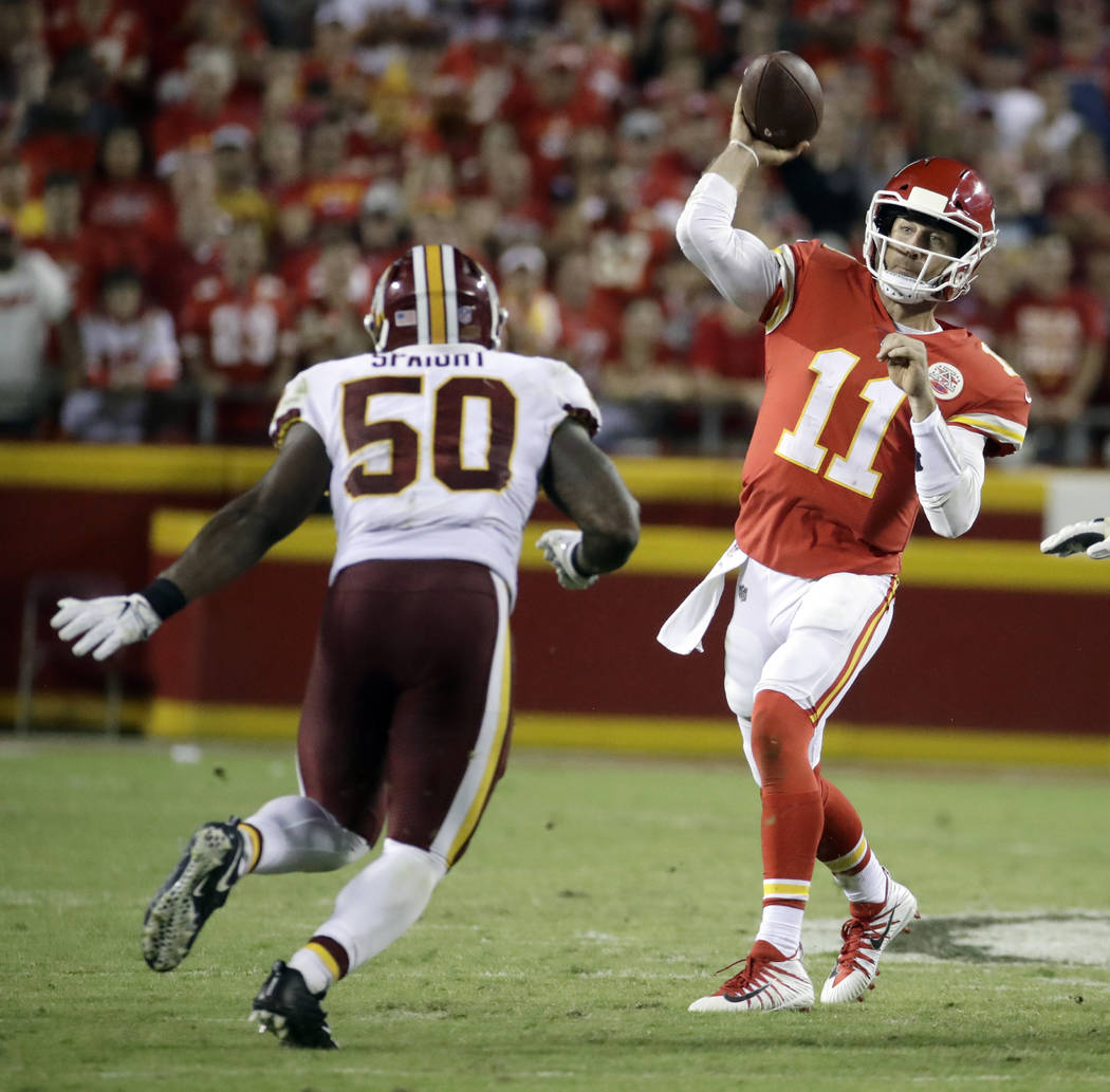 Kansas City Chiefs quarterback Alex Smith (11) throws as Washington Redskins linebacker Martrell Spaight (50) applies pressure, during the second half of an NFL football game in Kansas City, Mo.,  ...