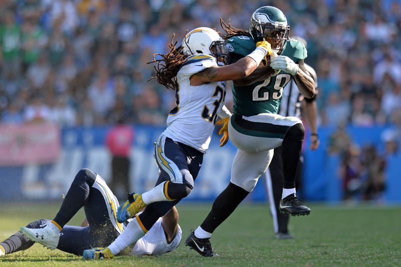 Oct 1, 2017; Carson, CA, USA; Philadelphia Eagles running back LeGarrette Blount (29) is defended by Los Angeles Chargers free safety Tre Boston (33) during the fourth quarter at StubHub Center. M ...