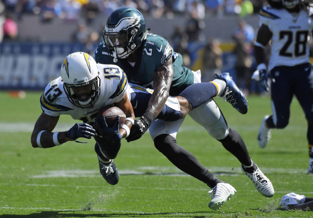 Los Angeles Chargers wide receiver Keenan Allen (13) makes a catch as Philadelphia Eagles strong safety Malcolm Jenkins defends during the first half of an NFL football game Sunday, Oct. 1, 2017,  ...