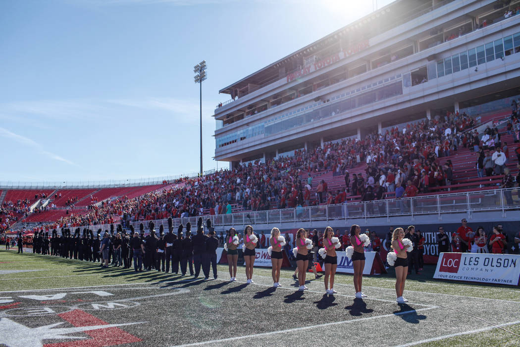 UNLV Rebels band and cheerleaders face the American flag during the national anthem before the start of a football game against Utah State Aggies at Sam Boyd Stadium in Las Vegas, Saturday, Oct. 2 ...