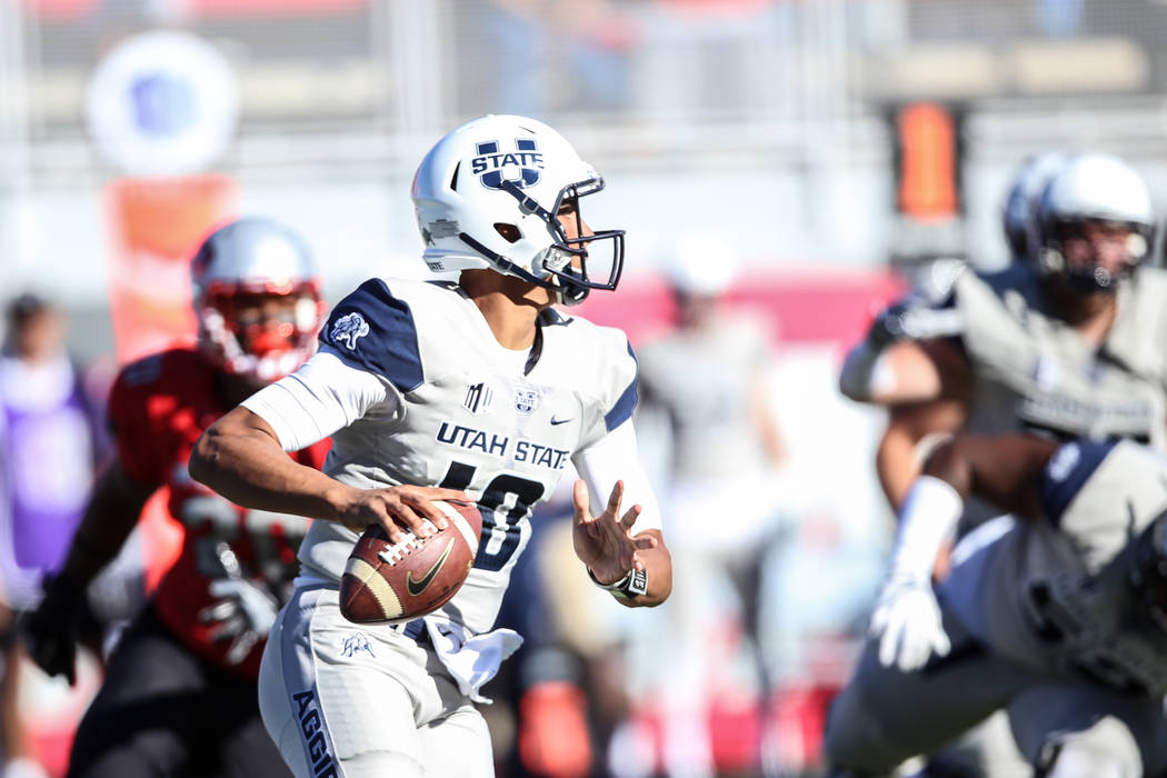 Utah State Aggies quarterback Jordan Love (10) runs with ball against the UNLV Rebels during the first quarter of a football game at Sam Boyd Stadium in Las Vegas, Saturday, Oct. 21, 2017. Joel An ...
