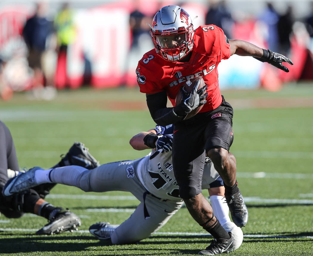 UNLV Rebels running back Lexington Thomas (3) runs the ball against Utah State Aggies during the first quarter of a football game at Sam Boyd Stadium in Las Vegas, Saturday, Oct. 21, 2017. Joel An ...