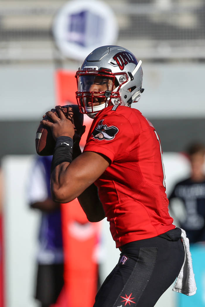 UNLV Rebels quarterback Armani Rogers (1) prepares to pass the ball against the Utah State Aggies during the first quarter of a football game at Sam Boyd Stadium in Las Vegas, Saturday, Oct. 21, 2 ...