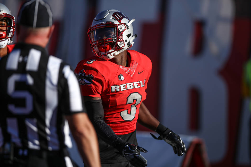 UNLV Rebels running back Lexington Thomas (3), right, scores a touchdown against the Utah State Aggies during the second quarter of a football game at Sam Boyd Stadium in Las Vegas, Saturday, Oct. ...