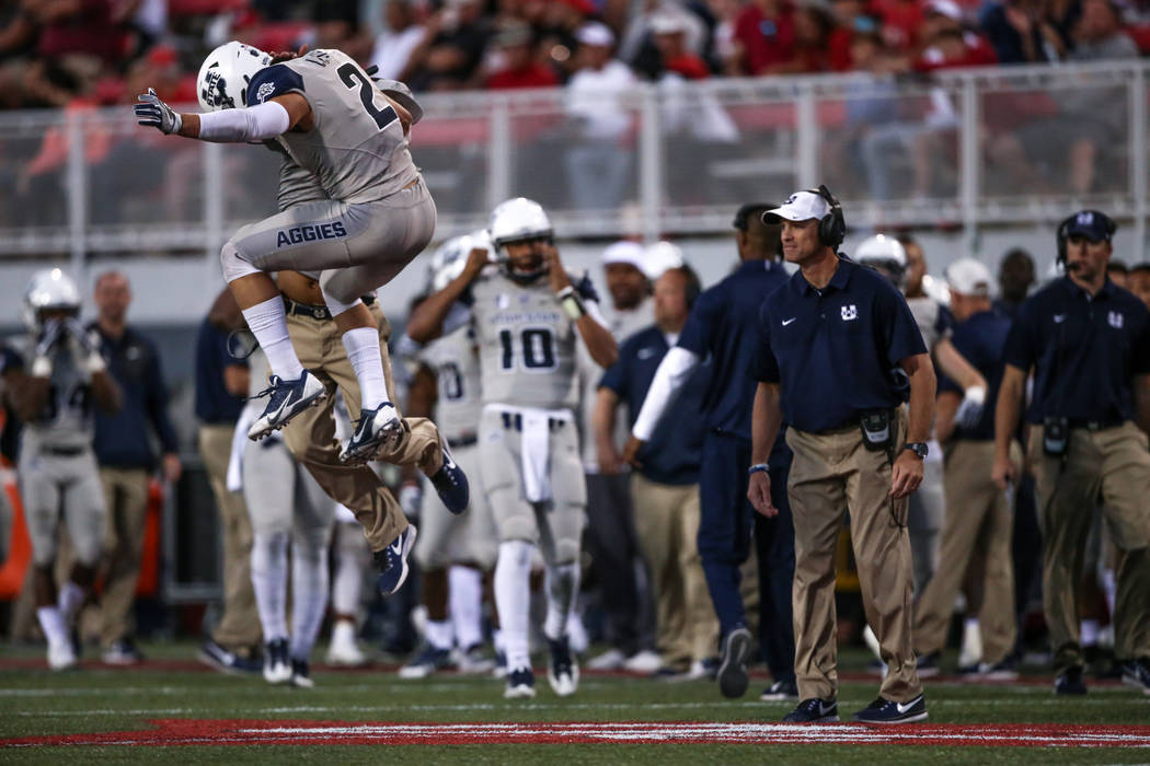 Utah State Aggies safety Dallin Leavitt (2) jumps as he celebrates after catching an interception against the UNLV Rebels during the fourth quarter of a football game at Sam Boyd Stadium in Las Ve ...