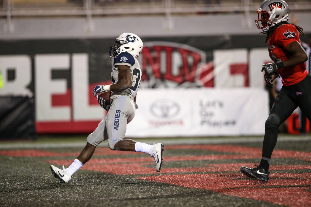 Utah State Aggies running back Justen Hervey (34) scores a touchdown against the UNLV Rebels during the fourth quarter of a football game at Sam Boyd Stadium in Las Vegas, Saturday, Oct. 21, 2017. ...