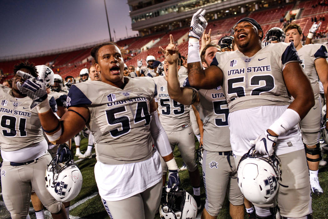 The Utah State Aggies celebrate after defeating the UNLV Rebels at the end of a football game at Sam Boyd Stadium in Las Vegas, Saturday, Oct. 21, 2017. Utah State Aggies won 52-28. Joel Angel Jua ...