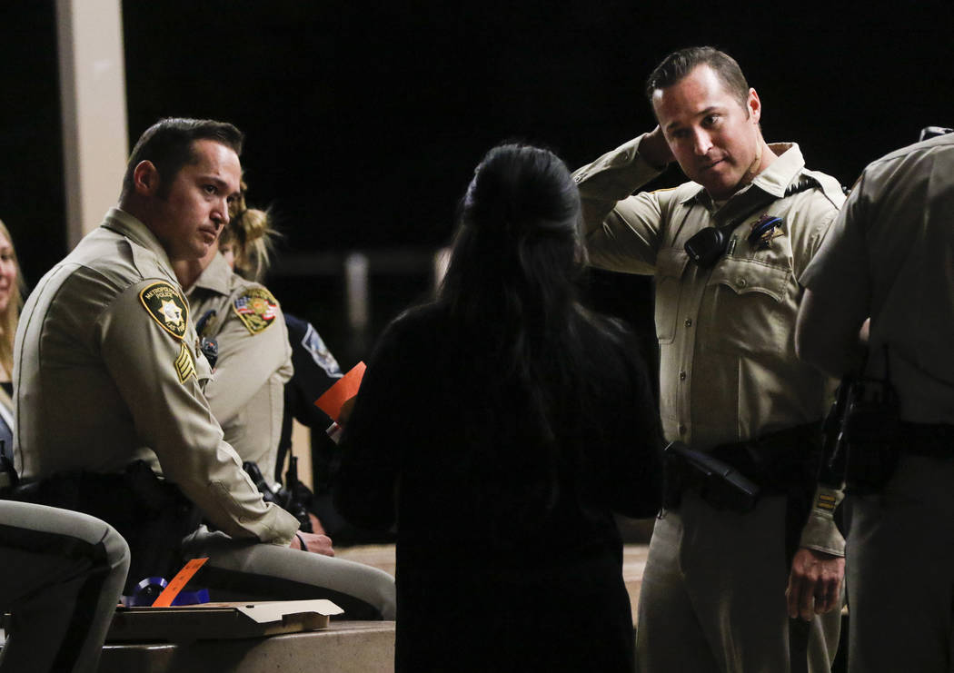 Las Vegas police officer Casey Clarkson, right, next to his twin brother, Sgt. Branden Clarkson, after a candlelight vigil for fellow officer Charleston Hartfield, who was killed while off-duty in ...