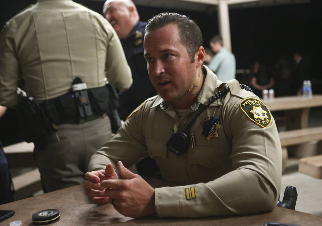 Las Vegas police officer Casey Clarkson after a candlelight vigil for fellow officer Charleston Hartfield, who was killed while off-duty in Sunday's mass shooting, at Police Memorial Park in Las V ...