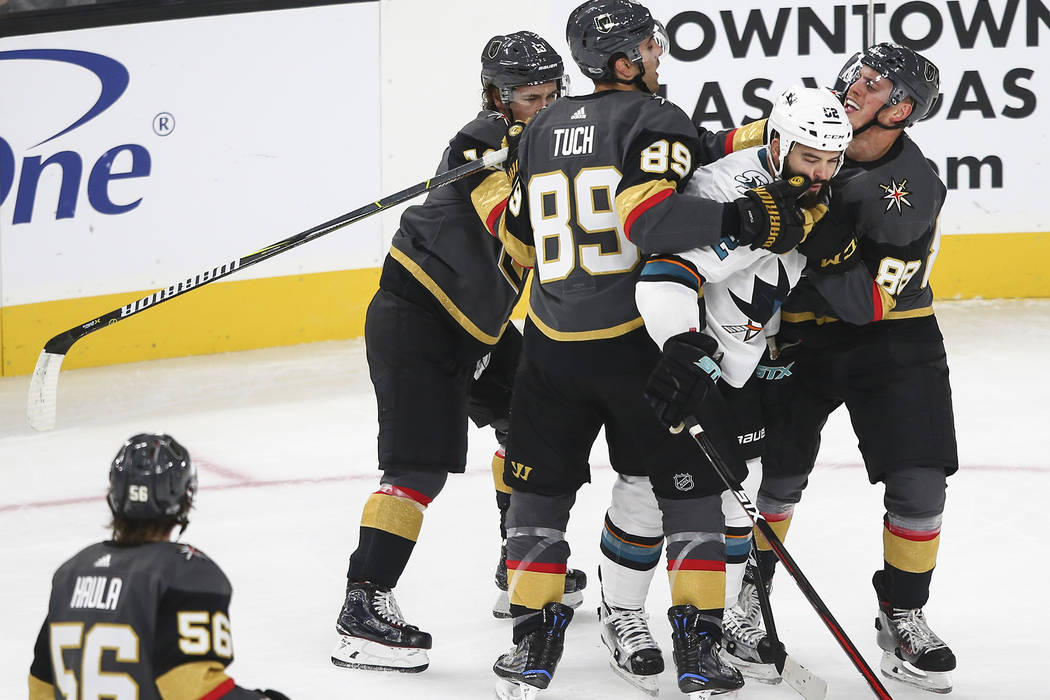 Golden Knights players including Alex Tuch (89) and Nate Schmidt (88) get into an altercation with San Jose Sharks' Brandon Bollig (52) during the first period of an NHL preseason hockey game at T ...