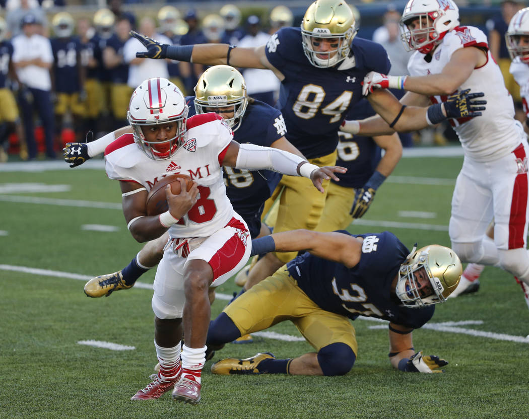 Miami (Ohio's) Jaylon Bester makes a spin move on his kickoff return during the first half of an NCAA college football game Saturday, Sept. 30, 2017, in South Bend, Ind. (AP Photo/Charles Rex Arbo ...
