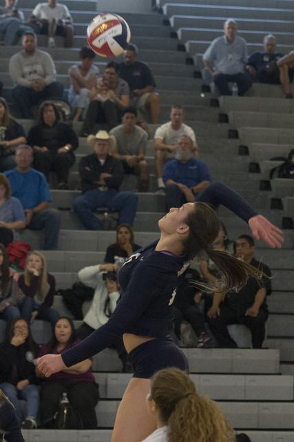 Shadow Ridge's Whittnee Nihipali (15) hits the ball against Durango during a Sunset Region girls volleyball semifinal match at Durango in Las Vegas, Thursday, Nov. 3, 2016. Jason Ogulnik/Las Vegas ...