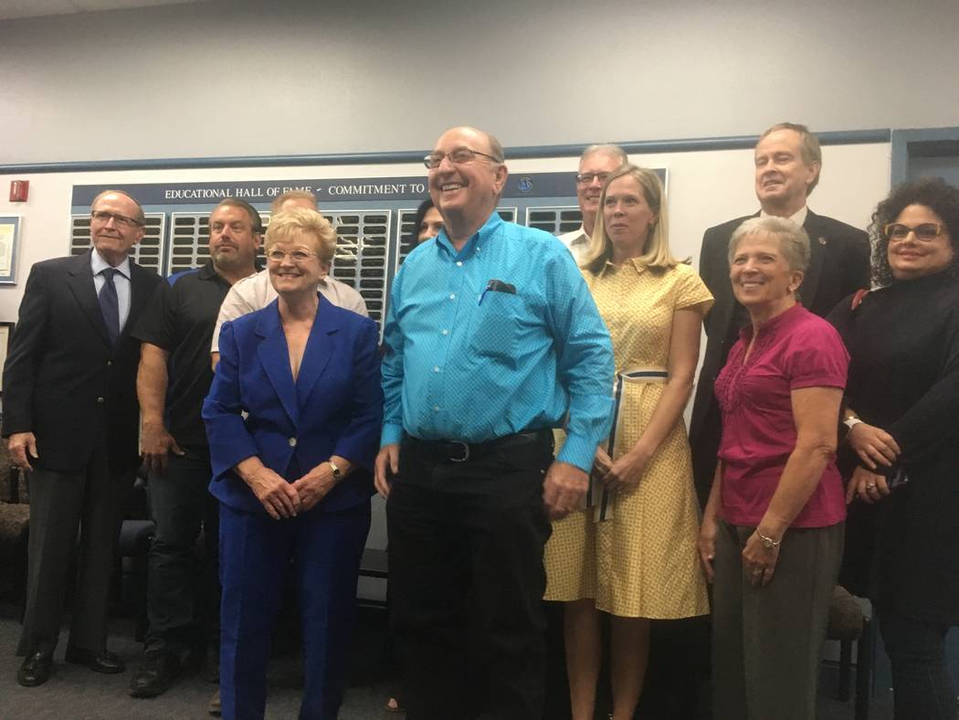 Robert and Sandy Ellis stand in front of a group of friends after the Clark County School Board moved to name a new Henderson elementary school after the couple. (Diego Mendoza-Moyers/View) @dmend ...
