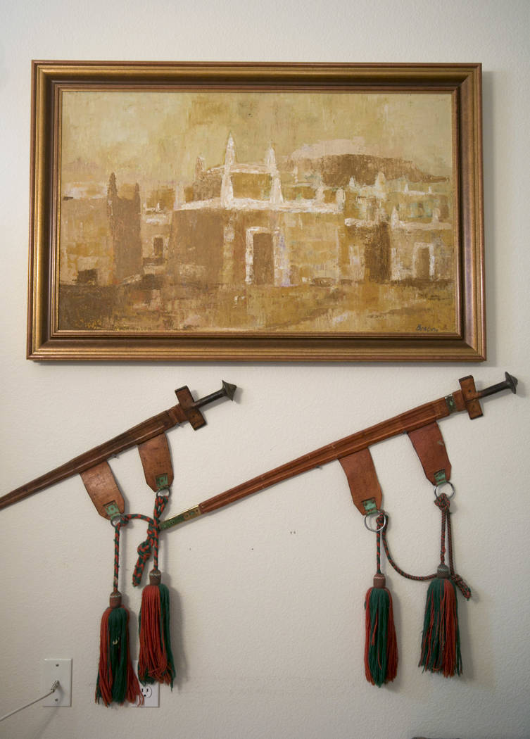 Dennis Ortwein's painting of Nigerian compound houses in Kano, Ningera and decorative swords at his home in Summerlin,  Las Vegas, on Wednesday, Sept. 13, 2017.  Ortwerin is one of four people who ...
