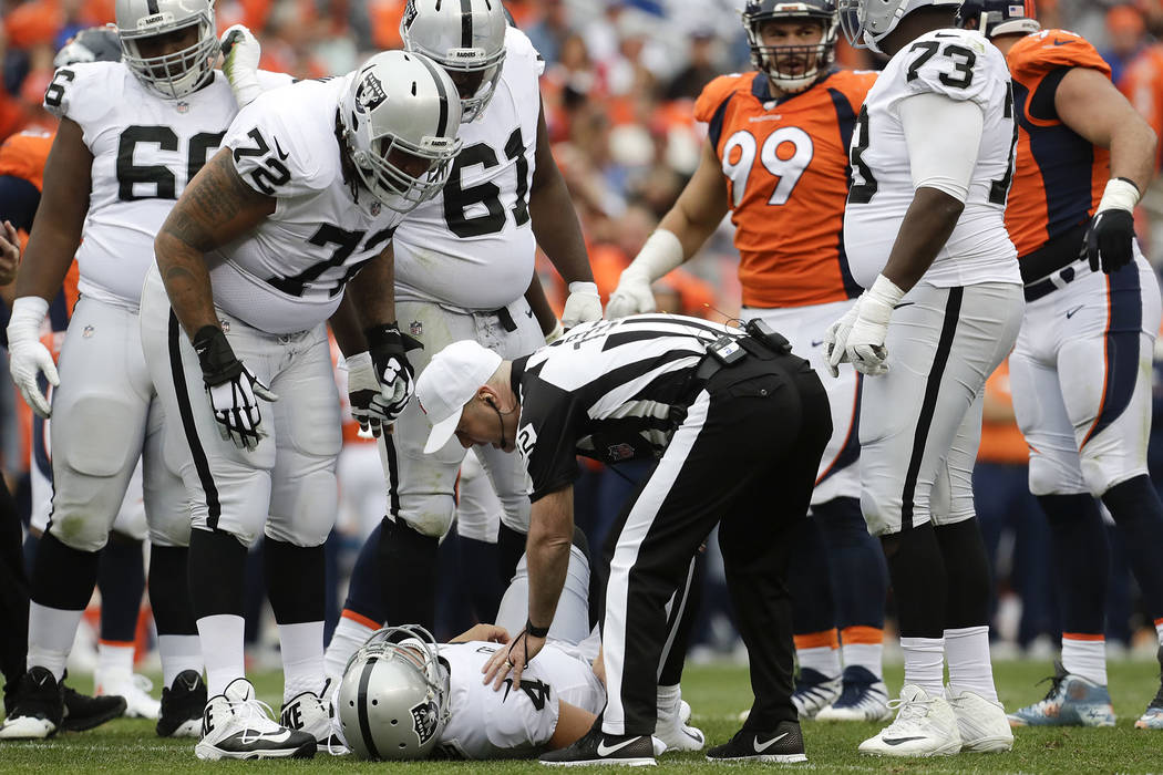 Oakland Raiders quarterback Derek Carr lays the field after being injured during the second half of an NFL football game against the Denver Broncos Sunday, Oct. 1, 2017, in Denver. (AP Photo/Joe M ...