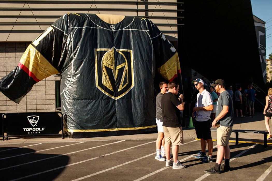 People gather outside Topgolf during a watch party for the Vegas Golden Knights season opener against the Dallas Stars in Las Vegas, Friday, Oct. 6, 2017. Proceeds from t-shirt sales at the event  ...