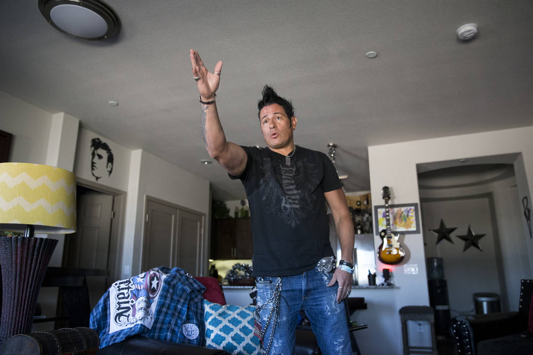 Bryan Hopkins, member of the band Elvis Monroe, and who attended Route 91 festival during the mass shooting last Sunday, shares his story at his home in Las Vegas, Thursday, Oct. 5, 2017. Erik Ver ...