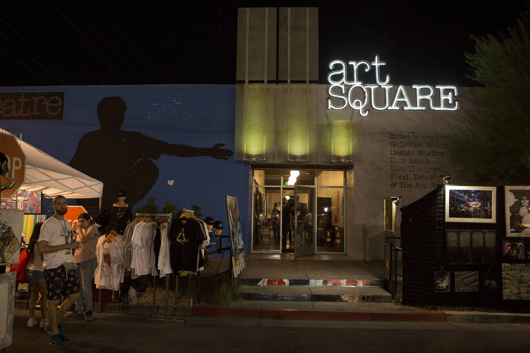 First Friday attendees walk past booths of art during First Friday in Las Vegas, Friday, Oct. 6, 2017. This is the 15th anniversary of First Friday downtown Las Vegas. Bridget Bennett Las Vegas Re ...