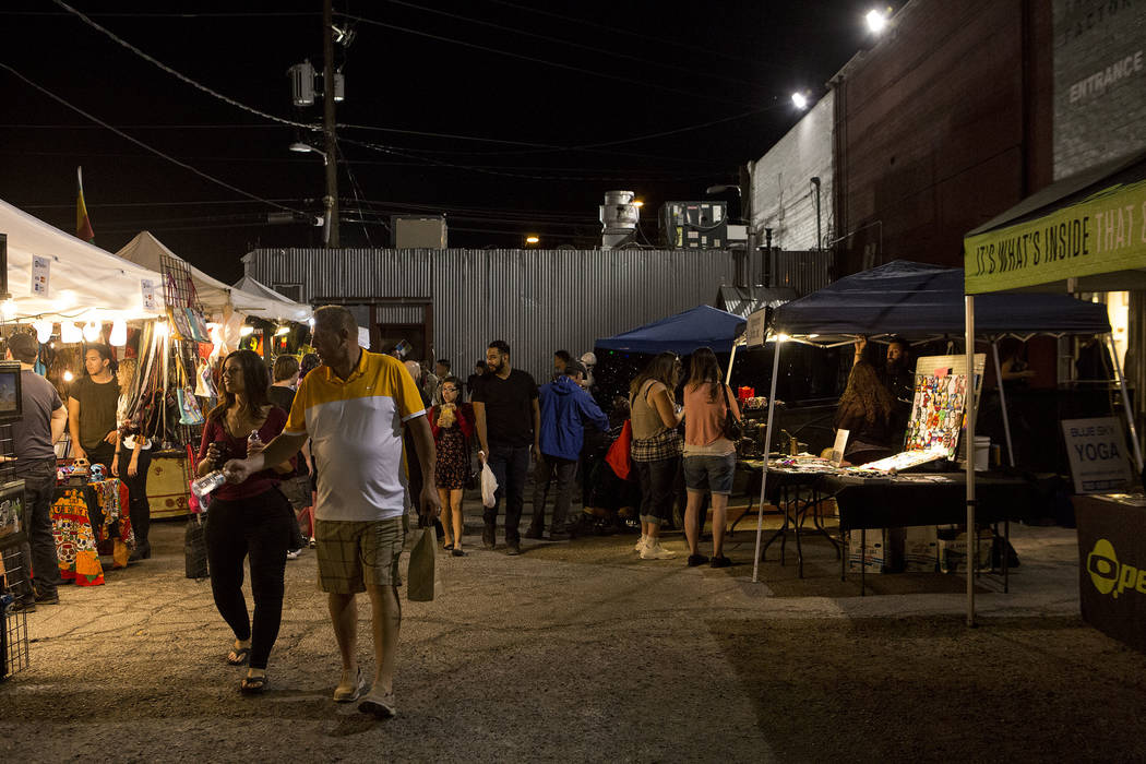 Attendees browse booths during First Friday in Las Vegas, Friday, Oct. 6, 2017. This is the 15th anniversary of First Friday downtown Las Vegas. Bridget Bennett Las Vegas Review-Journal @Bridgetkb ...